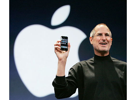Jobs poses with the new dimunitive device.